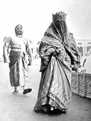 In the grandstand, before the arrival of Their Imperial Highnesses, Lilah meets for the first time the Begum of Bhopal, India's only female ruler. Prince Obaidulla, the Begum's son, walks behind his mother.